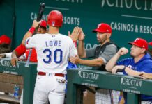 Greedy Rangers fan nabs ball from woman in stands (Video)